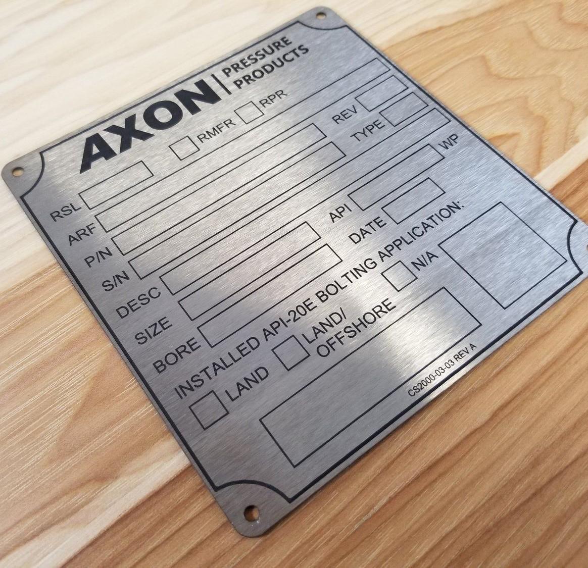 gravírování štítků Axon